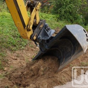 Tilting granding bucket for wheel loaders – excavators